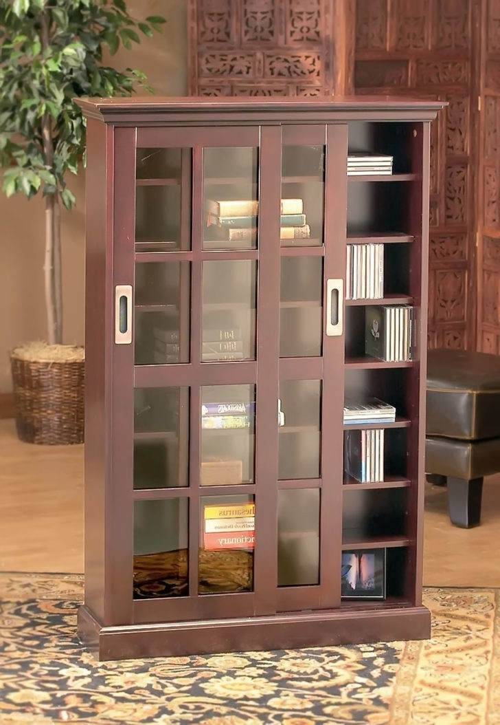 Bookcases With Sliding Glass Doors Inside Latest Brown Tall Wooden Bookcase Featuring Sliding Glass Doors On Semi (View 3 of 15)