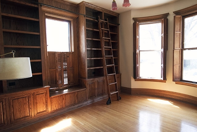 Wooden Library Ladders Throughout 2018 The Built In Bookshelves And Rolling Ladder In The Library (View 13 of 15)