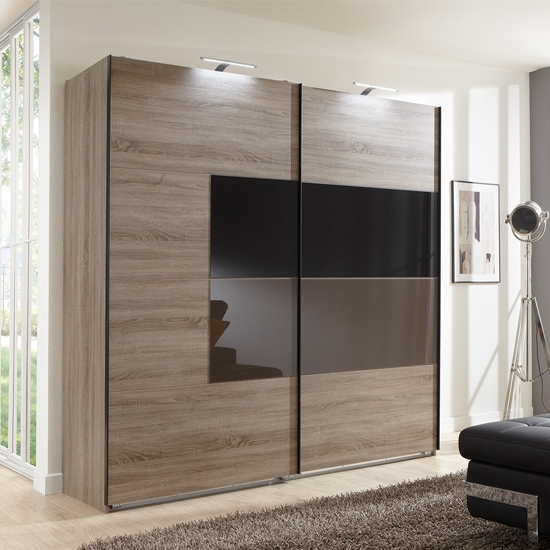 2018 Black Sliding Wardrobes Within Cairo Sliding Wardrobe In Montana Oak And Black Mocha Glass (View 2 of 15)