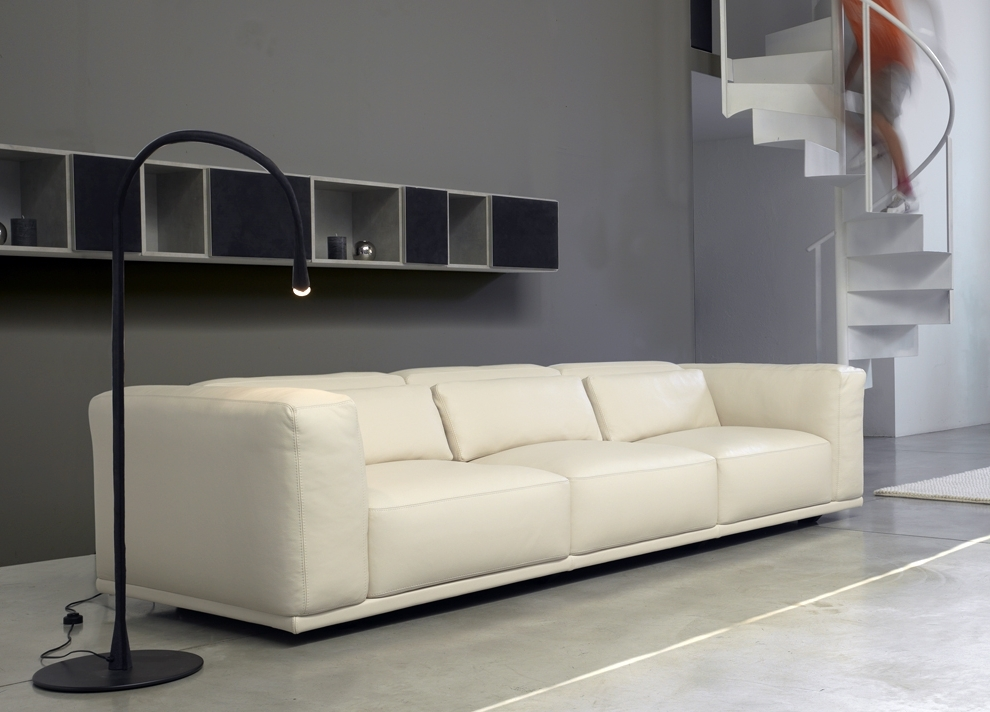 Best And Newest Long Black Floating Shelves Above Modern White Leathered Sofa Set For Long Modern Sofas (View 1 of 10)
