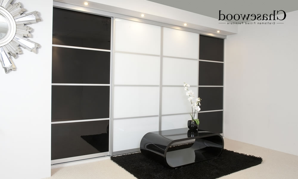 Black And White Wardrobes Set Intended For Popular Chasewood Fitted Wardrobe Showing Sliding Wardrobe Doors In Black (View 4 of 15)