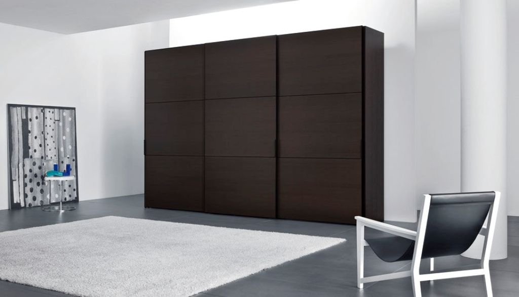 Famous Dark Brown Wardrobes In Dark Brown Wardrobe Design With Leather Chair And White Rug For (View 5 of 15)
