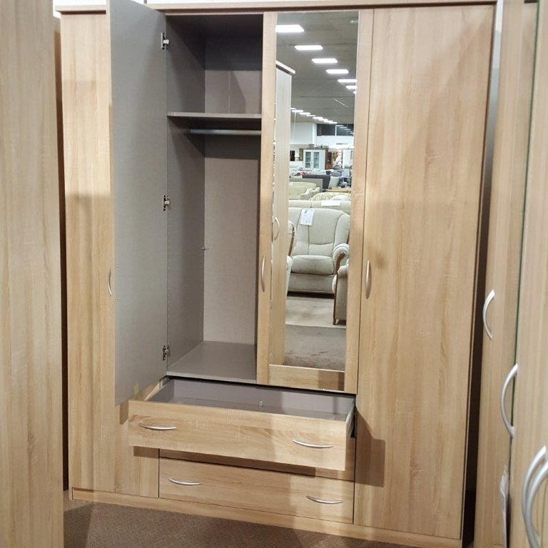 Fashionable Kent Wardrobes In Rauch Kent 4 Door Centre Mirror Wardrobe With Drawers (View 12 of 15)
