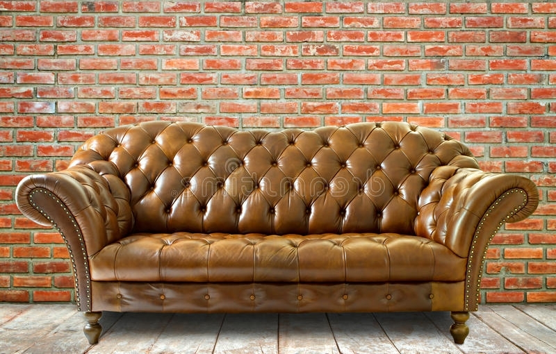 Most Up To Date The Brick Leather Sofas Intended For Vintage Style Leather Sofa With Wooden Floor And Brick Wall Stock (View 4 of 10)