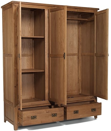 Oak Triple Door Wardrobe With Two Drawers Throughout Popular Oak Wardrobes With Drawers And Shelves (View 4 of 15)