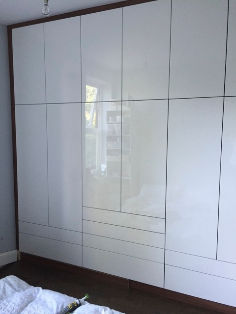 Popular High Gloss White Wardrobes Intended For High Gloss White Acrylic Doors On Walnut Carcass (View 13 of 15)