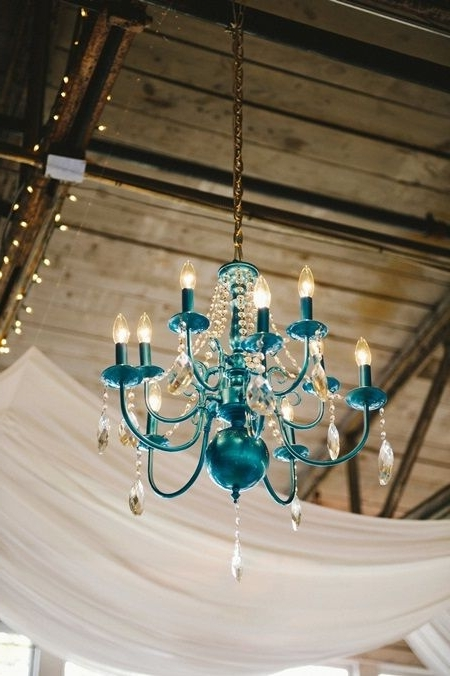Fashionable Turquoise Color Chandeliers Throughout A Cheery Wedding With A Turquoise, Orange And Yellow Color Palette (View 4 of 10)