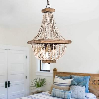 Hatfield 3 Light Novelty Chandeliers Throughout Trendy Highland Dunes Stapp Aged Wood Beaded 4 Light Empire Chandelier Highland  Dunes (View 11 of 30)