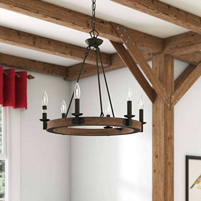 Pickensville 6 Light Wagon Wheel Chandeliers Regarding Most Popular Flavio 6 Light Wagon Wheel Chandelier (View 21 of 30)