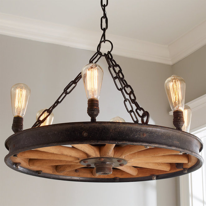 Shayla 12 Light Wagon Wheel Chandeliers Inside Fashionable Wagon Wheel Chandelier Beautiful Home Decoration (View 26 of 30)