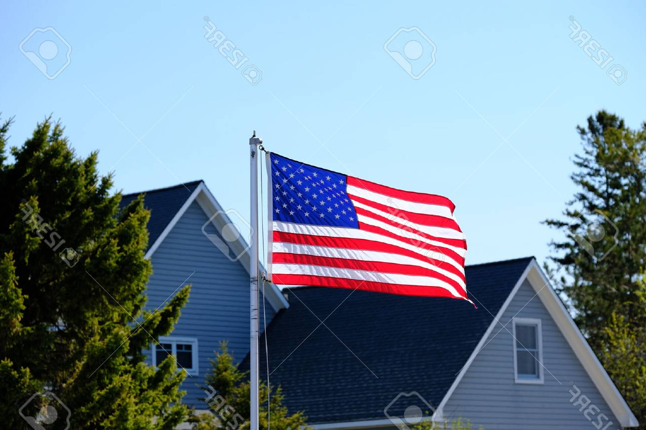 2019 American Flag Porch Swings Pertaining To American Flag At Suburban Neighborhood (View 2 of 30)