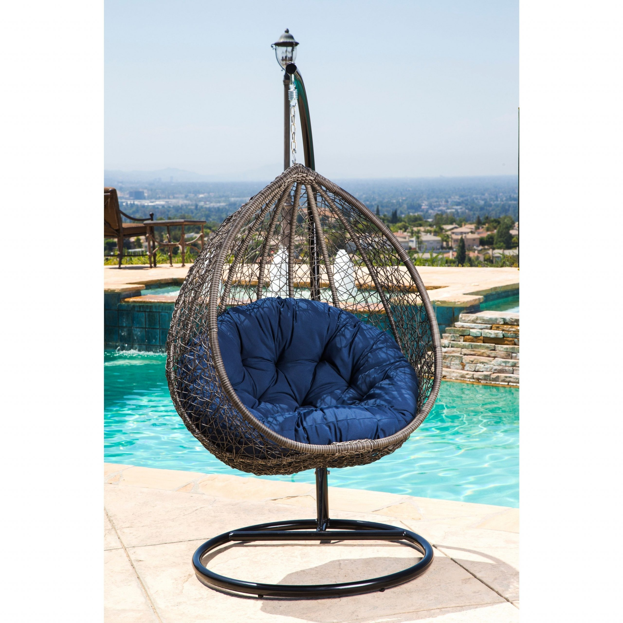 Abbyson Newport Outdoor Wicker Patio Swing Chair (brown/blue Pertaining To Best And Newest Outdoor Wicker Plastic Tear Porch Swings With Stand (View 24 of 30)