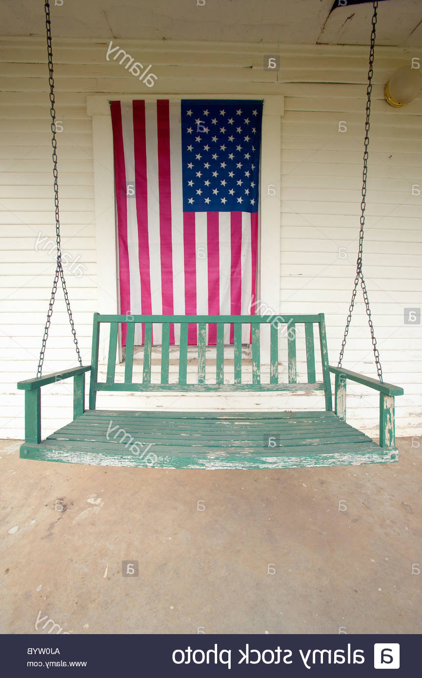 Best And Newest American Flag Porch Swings Within Old Swing On Porch Displaying An American Flag And Patriotic (View 13 of 30)