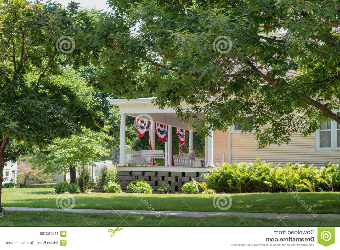 Charming Front Porch Decorated With American Flags For Within Preferred American Flag Porch Swings (View 14 of 30)