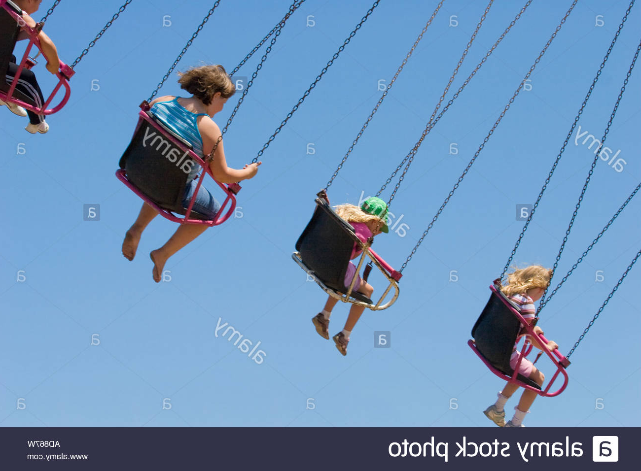 Children Flying In The Air On Seats Hanging From Chains On A Intended For Well Known Swing Seats With Chains (View 3 of 30)