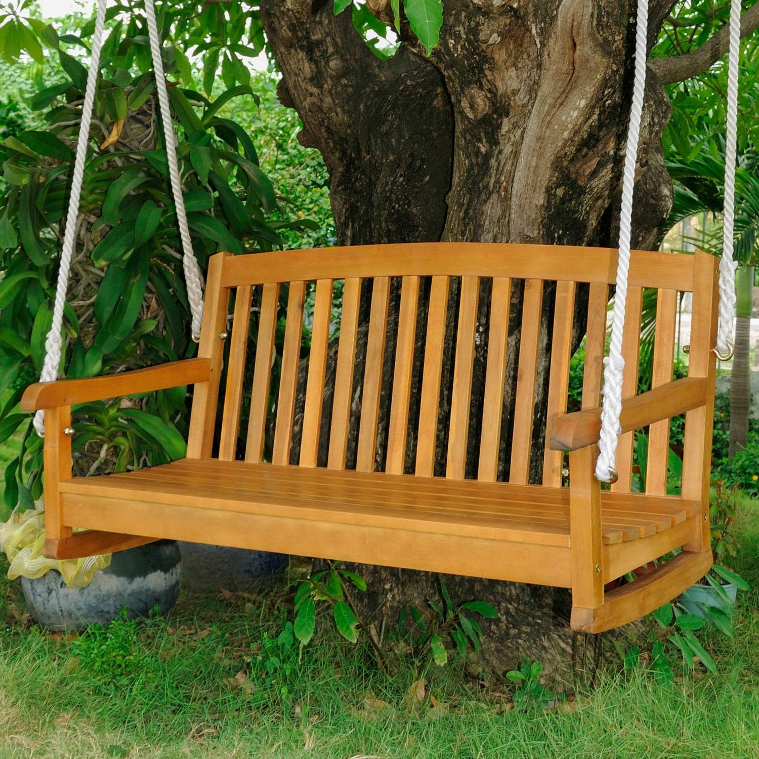 Fashionable 2 Person Light Teak Oil Wood Outdoor Swings For International Caravan Royal Tahiti Levindale Porch Swing In (Gallery 2 of 30)
