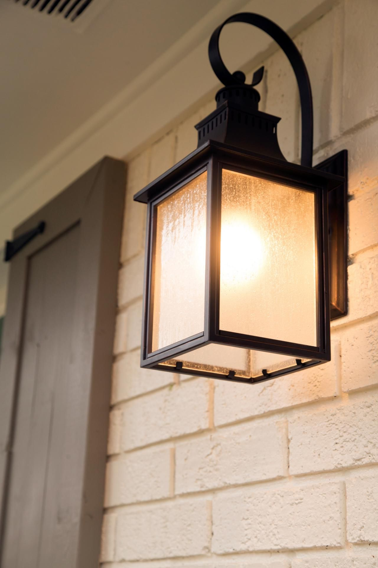 Modern Metal Sconces Provide Exterior Lighting On Either Inside Widely Used Lamp Outdoor Porch Swings (Gallery 20 of 30)