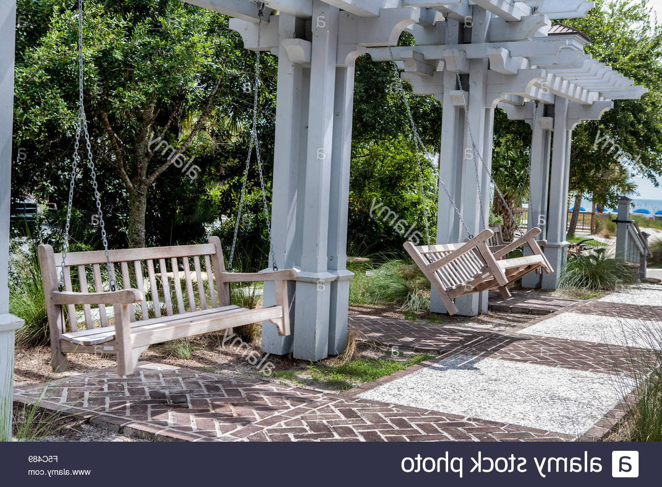 Popular Porch Swings Throughout Wood Porch Swings In Park Stock Photo: 89391913 – Alamy (View 15 of 30)