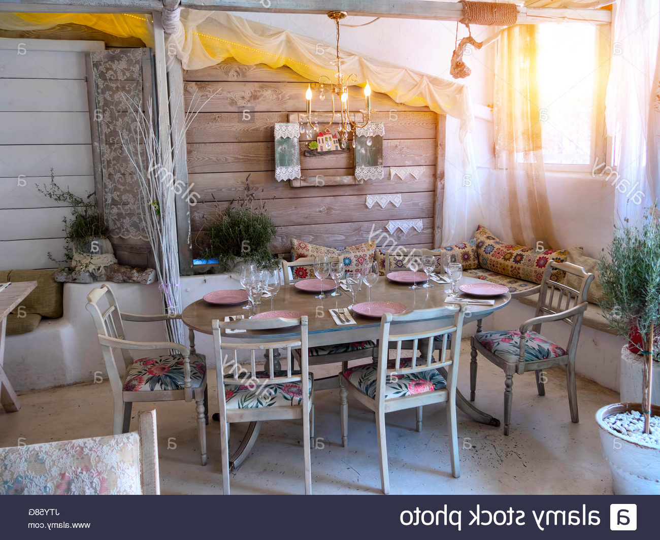Recent A Small Dining Room In A Rustic House, In An Old Style Stock For Small Rustic Look Dining Tables (View 24 of 30)