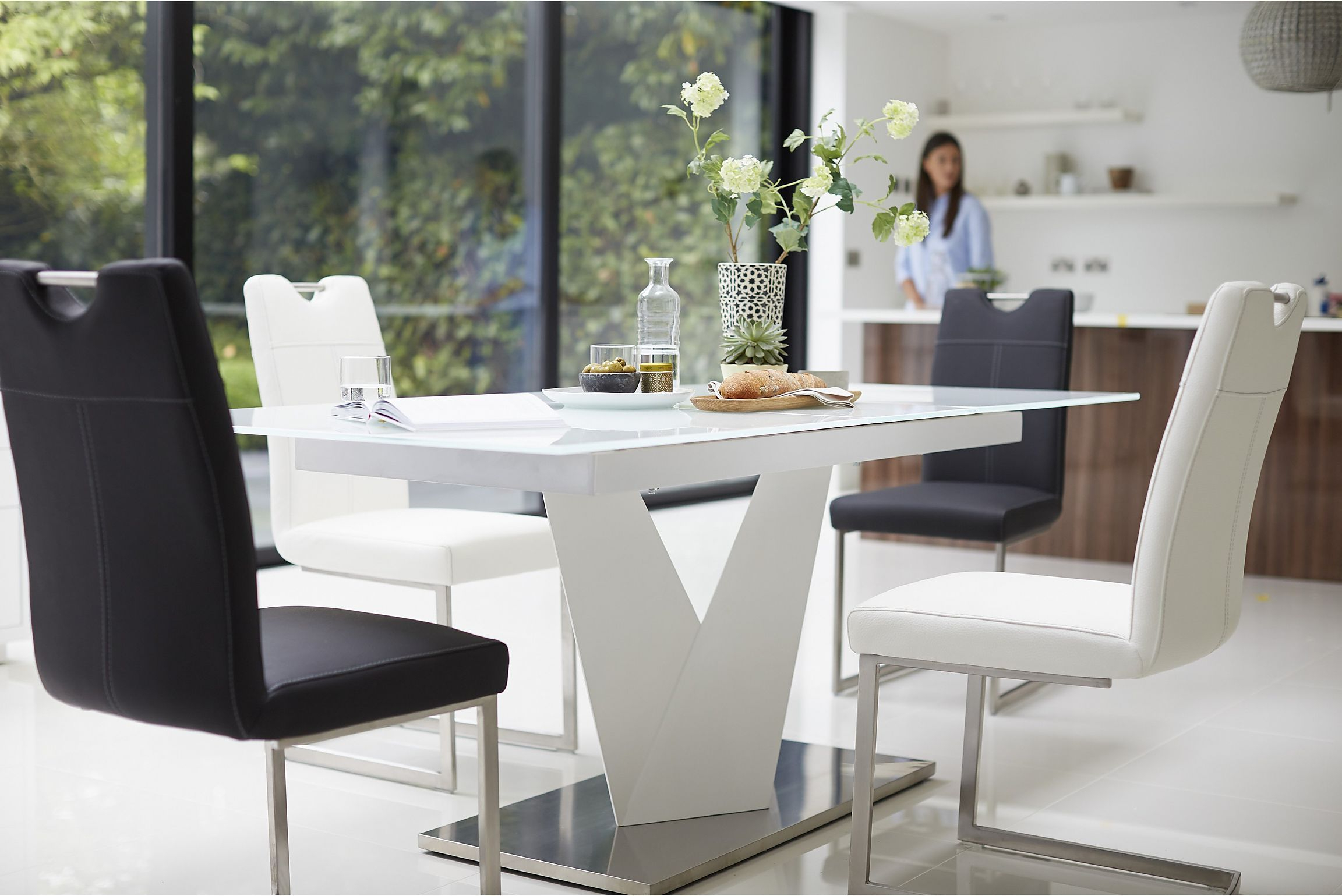 Recent Extending Ultra Modern Dining Table From Habufa Sits Up To 8 Intended For Modern Glass Top Extension Dining Tables In Stainless (View 25 of 30)
