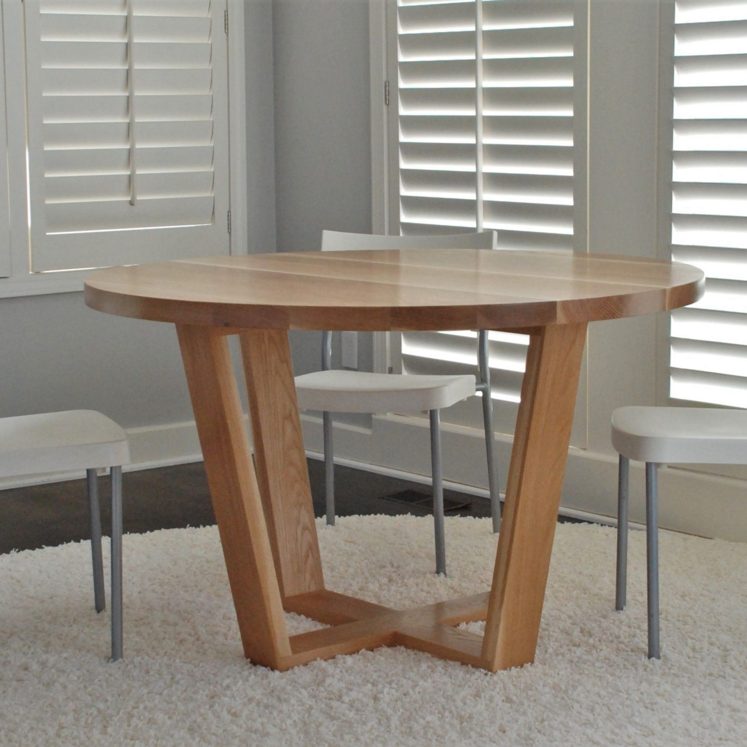 Solid Wood Circular Dining Tables White In Trendy Hand Crafted Angled Leg Round Dining Tablebelak (View 9 of 30)