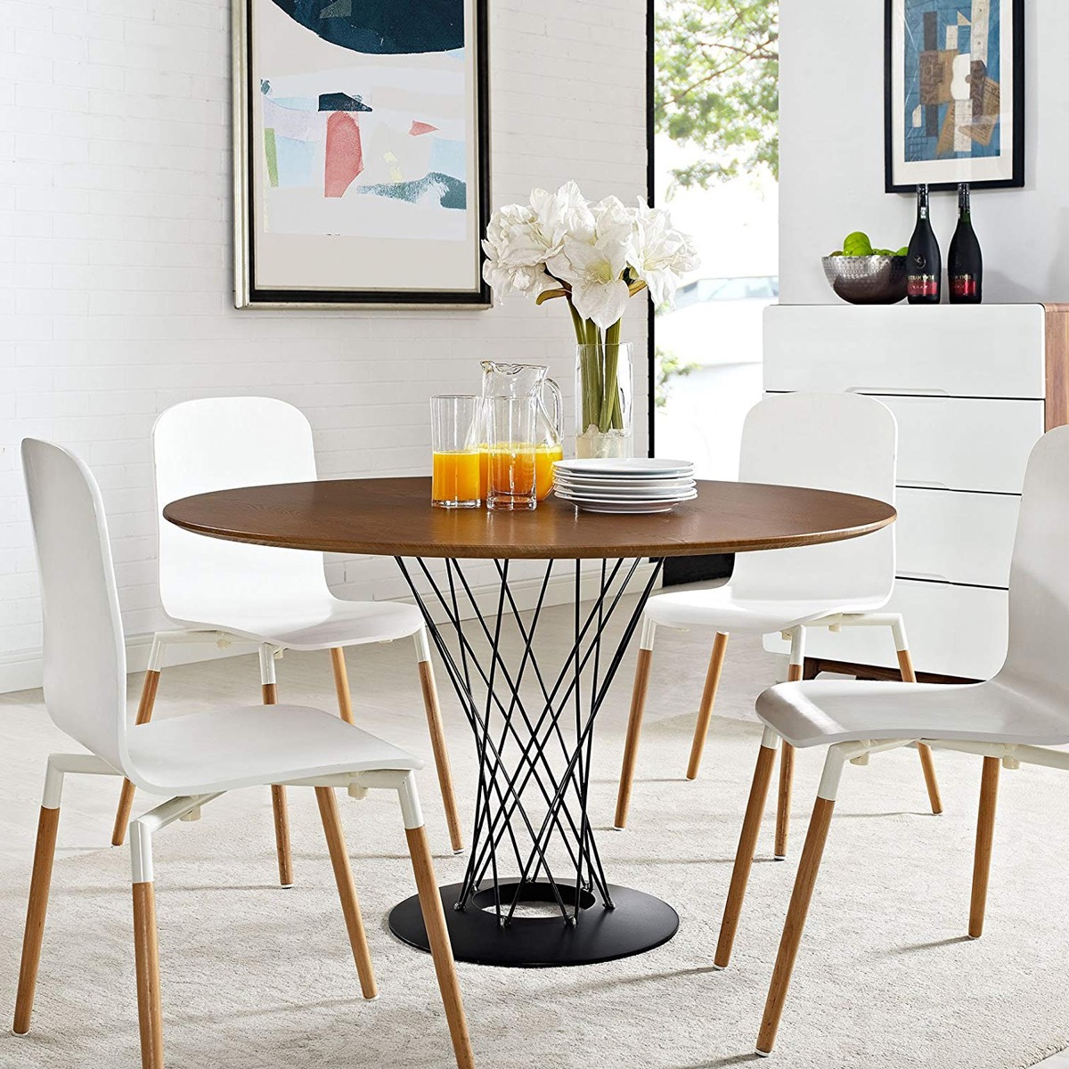 Widely Used Eames Style Dining Tables With Chromed Leg And Tempered Glass Top In 51 Round Dining Tables That Save On Space But Never Skimp On (View 30 of 30)