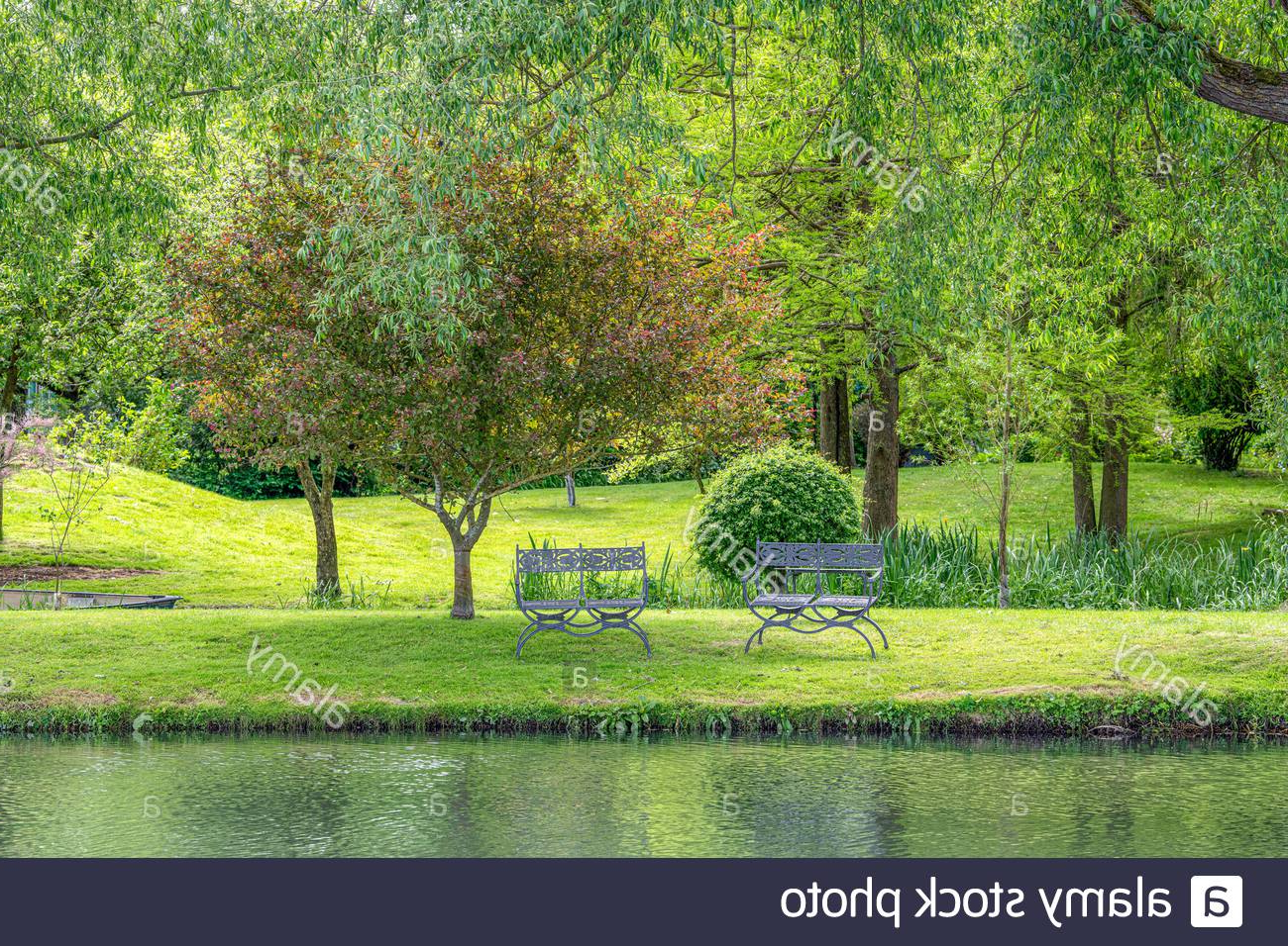 2020 Tranquil Garden With A River And A Seat Stock Photo – Alamy Throughout Weir Garden Stools (View 29 of 30)