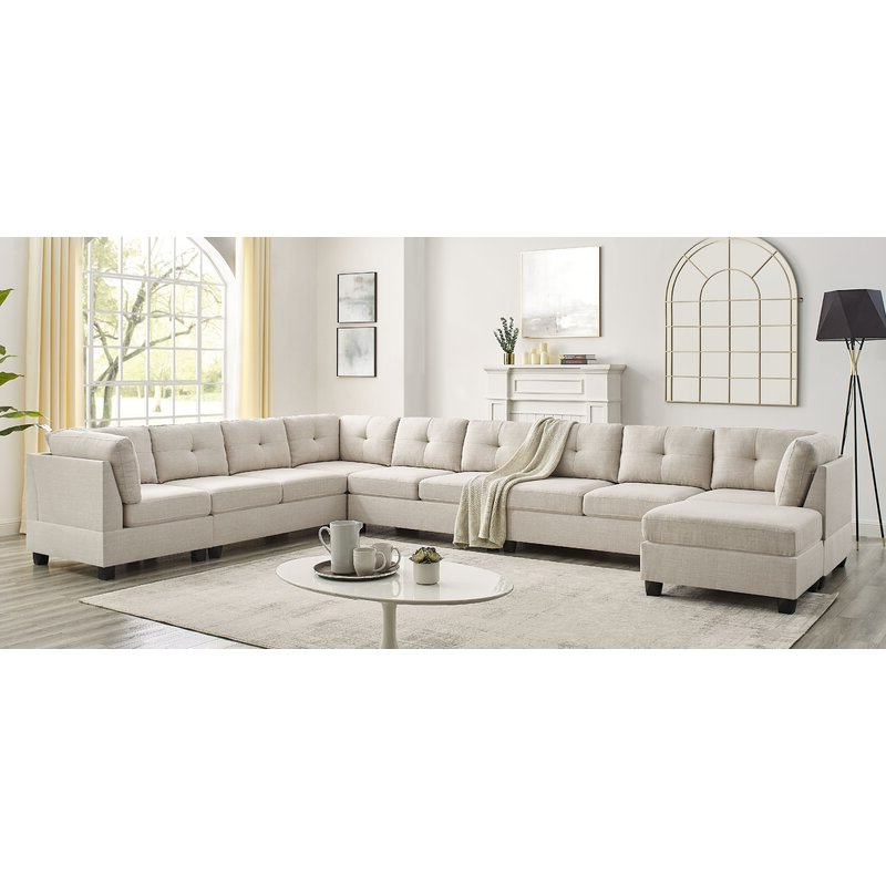 """Aelber 118"""" Wide Reversible Modular Sofa & Chaise Sectional With Ottoman Throughout Most Recent Annegret Faux Leather Barrel Chair And Ottoman Sets (View 25 of 30)"""